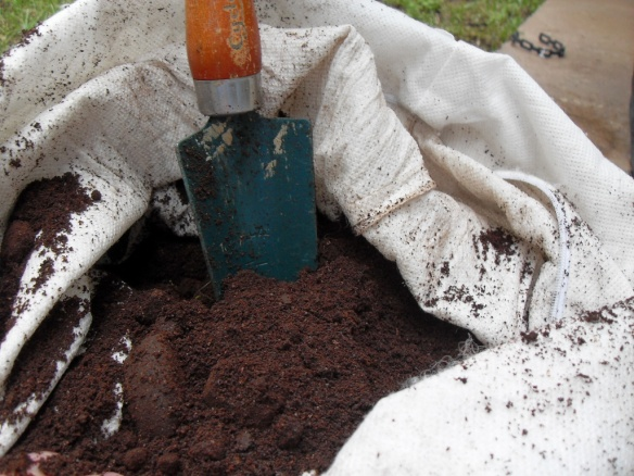 A bag full of coffee grounds for lawn