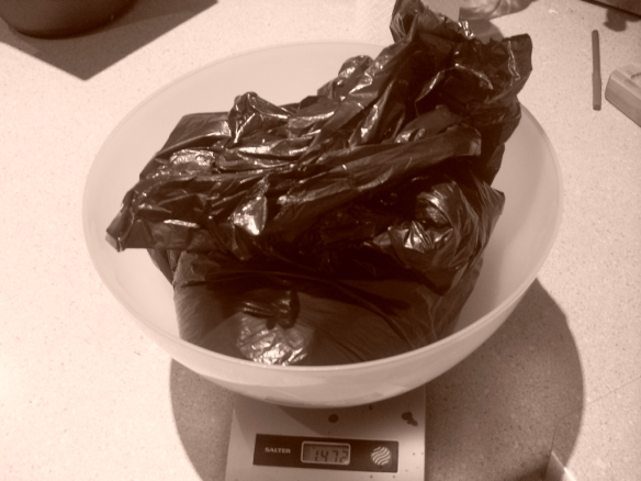 weighing used coffee grounds before drying