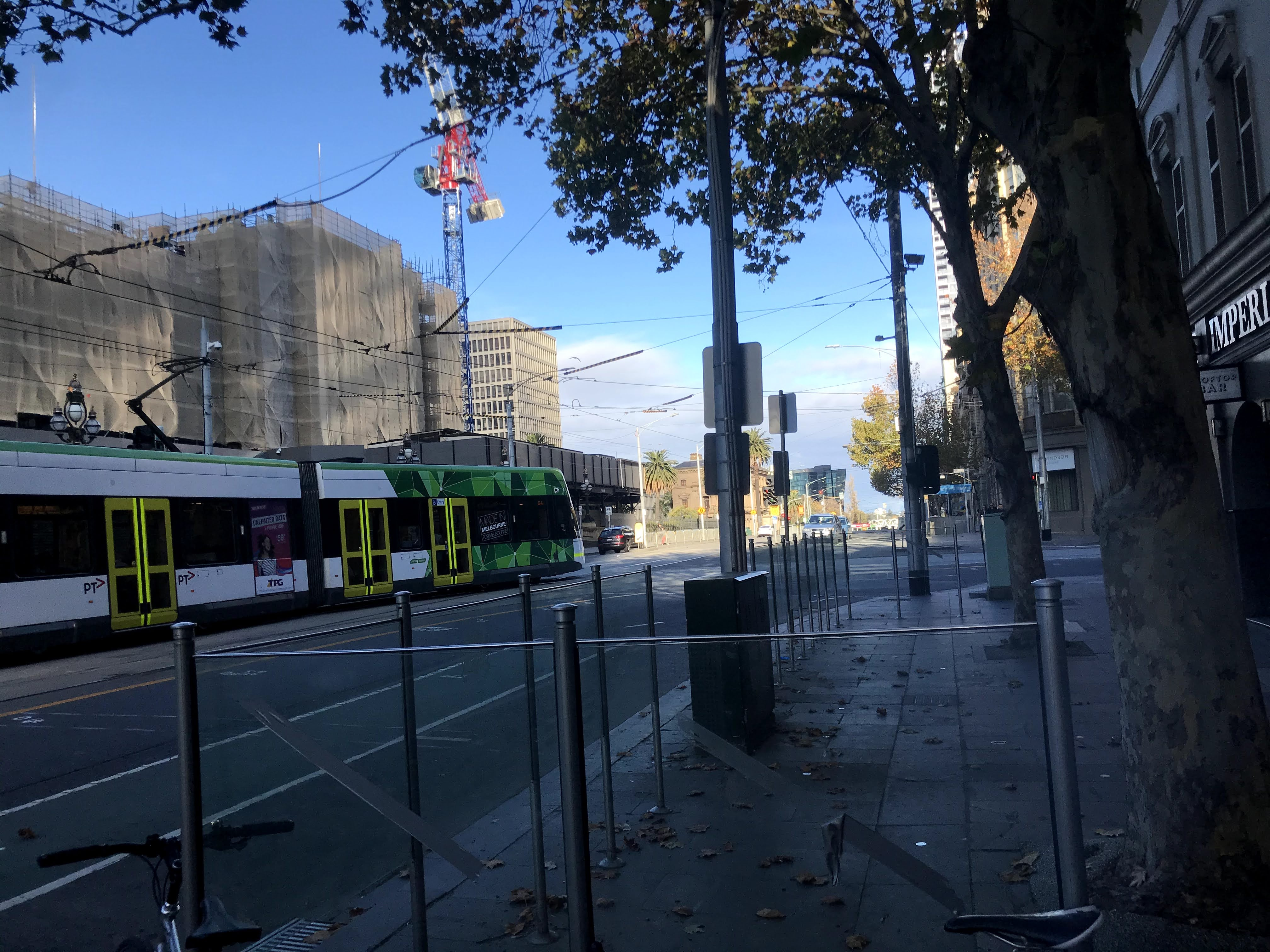 Melbourne city with passing tram
